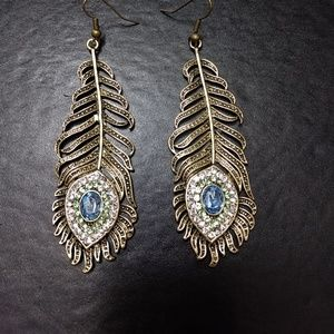 Gold tone peacock feather earrings